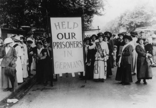 A crowd of female protestors in Britain, bearing a placard which reads \'Help Our Prisoners in Germany\', circa 1914. They are protesting the internment of thousands of British civilians at Ruhleben (now a district of Berlin) at the start of World War I. (Photo by Central Press/Hulton Archive/Getty Images)