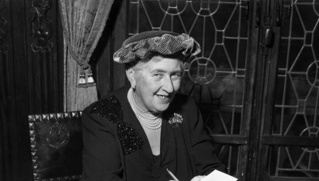 circa 1965: British mystery author Agatha Christie (1890-1976) autographing French editions of her books.
