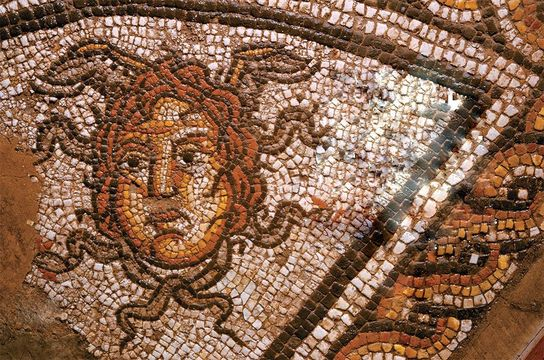 Medusa's head is depicted in the Roman Dyer Street mosaic, reconstructed at the Corinium Museum at Cirencester.