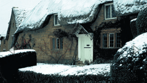 Snow decorates a thatched cottage in Great Tew.[