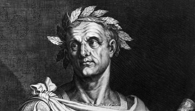Circa 50 BC, Julius Caesar (102 BC - 44 BC) as dictator of Rome wearing a crown of laurel and holding a symbol of office