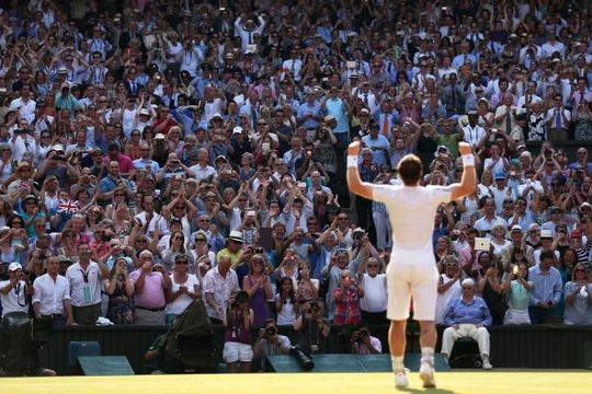Fans cheer and take photographs as Andy Murray of Great Britain celebrates victory in the Gentlemen\'s Singles Final match against Novak Djokovic of Serbia