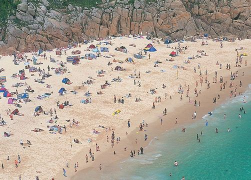 Like many of the tiny cove beaches along the Penwith coast, the fine sands and azure waters of the beach at Porthcurno give a Mediterranean flavor to southern Cornwall.
