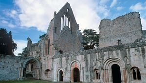 In the prettiest setting of the four great Border abbeys, Dryburgh Abbey is still a place of pilgrimage—to the final resting place of Sir Walter Scott.