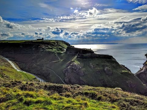 Tintagel Castle perched precariously in the mists of history on the Cornish clifftop.