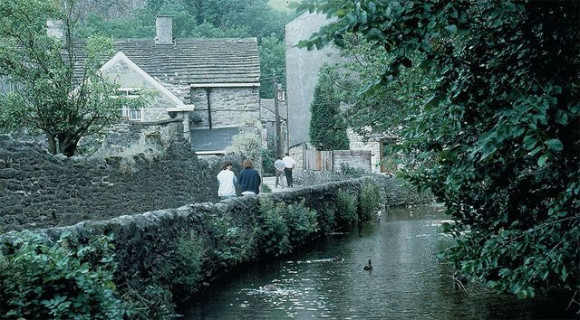 """Visitors stroll down the pretty riverside walk from the Peak Cavern to the village of Castleton, nicknamed """"Gem of the Peaks."""""""