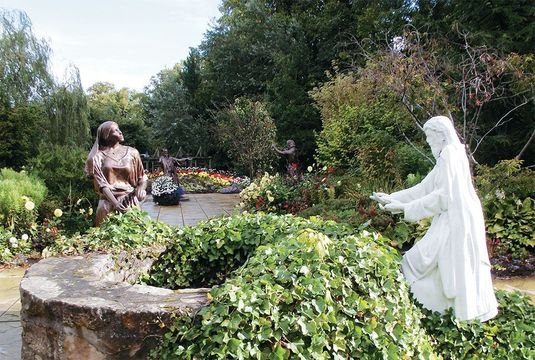 Jesus greets the Samaritan woman at the well in Elgin's Biblical Garden.