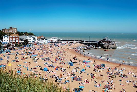 Broadstairs' Viking Bay has been a haven for summer sun-seekers for generations. The fortress-like house on the rise behind was Charles Dickens' residence, long known as Bleak House.