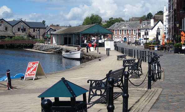 Quayside on the River Exe draws folk for river cruises or browsing in its shops and galleries.