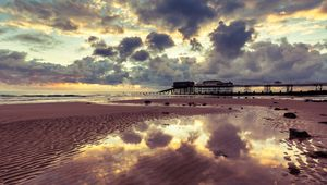 Tides out and the sun rises on Cromer beach, Norfolk, uk