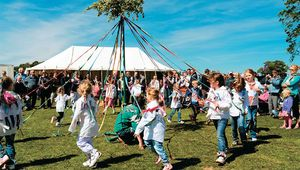 Schoolgirls dance around the maypole at the spring fête in Dilwyn, Herefordshire.