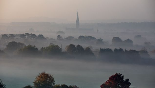 Mist surrounds Salisbury Cathedral as dawn breaks in Salisbury on October 10, 2018 in Wiltshire, England