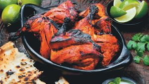 "Tandoori chicken is marinated in yoghurt and spices then roasted in a clay oven called a ""tandoor."""