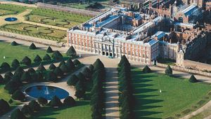 The huge tapered yews of Hampton Court Palace shaped the view from the front windows for King Henry VIII and his court.