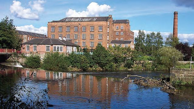 Like all the 18th and 19th-century textile mills, Darley Abbey Mills sits next to a river—the water providing the power that drove its vast machinery. DERWENT VALLEY MILLS