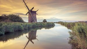 Abandoned Windmill on norfolk broads at sunset