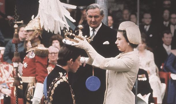 Queen Elizabeth II dubs Prince Charles, The Prince of Wales, in 1969.