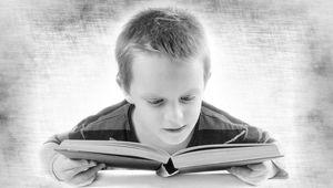 Thumb boy reading