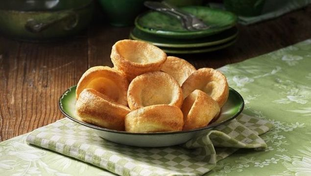 Bowl of yorkshire pudding with green colour pottery - stock photo