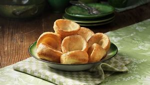 Bowl of Yorkshire pudding with green colour pottery.