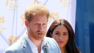 Meghan, Duchess of Sussex looks on as Prince Harry, Duke of Sussex speaks during a visit a township to learn about Youth Employment Services on October 02, 2019 in Johannesburg, South Africa