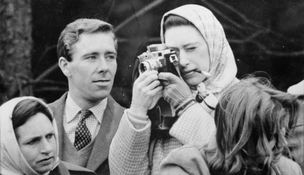 Professional photographer Antony Armstrong-Jones, the Earl of Snowdon, watches critically as his fiancee Princess Margaret (1930 - 2002) takes a snap at the Badminton Horse Trials