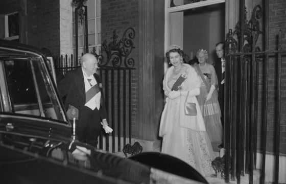 Queen Elizabeth II and Prince Philip leave 10 Downing Street in London after having dinner with Sir Winston Churchill (1874 - 1965), the British Prime Minister and his wife.
