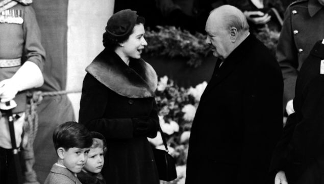 Elizabeth II, Queen of England with Prince Charles and Princess Anne chatting to Sir Winston Churchill