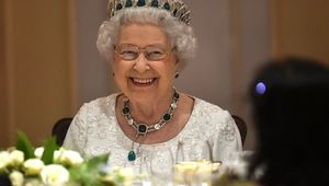 Queen Elizabeth II smiles as she attends a dinner at the Corinthia Palace Hotel in Attard in November 27, 2015.