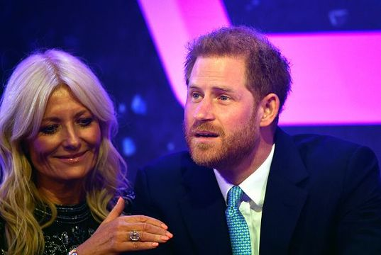 Prince Harry, Duke of Sussex reacts next to television presenter Gaby Roslin as he delivers a speech during the WellChild awards at Royal Lancaster Hotel on October 15, 2019 in London, England. (Photo by Toby Melville - WPA Pool/Getty Images)