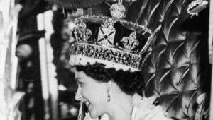 Queen Elizabeth II wearing the State Crown and carrying the State orb in a Royal carriage after her Coronation ceremony. Original Publication: Picture Post - 6537 - The Coronation Of Queen Elizabeth - pub. 1953.