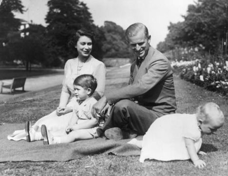 Princess Elizabeth and Prince Philip, Duke of Edinburgh with their two children, Prince Charles and Princess Anne in the grounds of Clarence House, London.