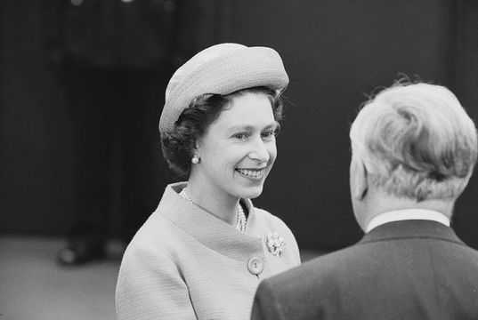 Elizabeth II, Queen of the United Kingdom, with the Prime Minister of the United Kingdom Harold Wilson (1916 - 1995) at Waterloo Station, London, UK, 31st May 1965.