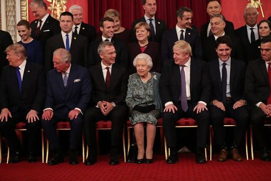 Queen Elizabeth II, German Chancellor Angela Merkel and Prime Minister Boris Johnson join other Nato leaders for a group photograph at a reception for NATO leaders hosted by Queen Elizabeth II at Buckingham Palace on December 3, 2019 in London, England. Her Majesty Queen Elizabeth II hosted the reception at Buckingham Palace for NATO Leaders to mark 70 years of the NATO Alliance. (Photo by Yui Mok - WPA Pool/Getty Images)