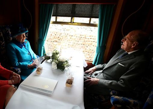 Queen Elizabeth II and Prince Philip, Duke of Edinburgh, travel on a steam train to inaugurate the new £294 million Scottish Borders Railway, on the day the Queen becomes Britain\'s longest reigning monarch, on September 9, 2015 in Tweedbank, England. (Photo by Andrew Milligan - WPA Pool/Getty Images)