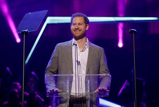 Britain\'s Prince Harry gives a speech on stage before announcing the winners of the Health and Wellbeing category at the inaugural OnSide Awards at the Royal Albert Hall on November 17, 2019 in London, United Kingdom. (Photo by Matt Dunham – WPA Pool/Getty Images)