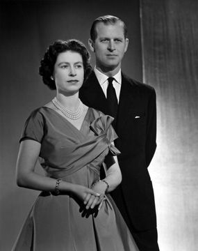 Queen Elizabeth II and Prince Philip, Duke of Edinburgh pose for a portrait at home in Buckingham Palace in December 1958 in London, England. (Photo by Donald McKague/Michael Ochs Archives/Getty Images)