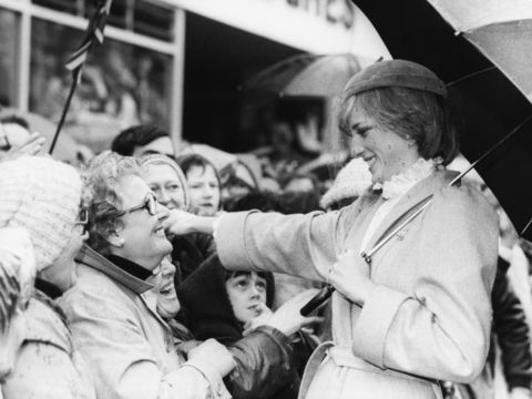 Princess Diana of Wales smiling as she prepares to embrace a woman in the crowd, on the streets of Carmarthen, Wales, October 29th 1981. (Photo by Central Press/Hulton Archive/Getty Images)