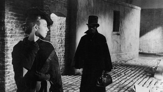 Unknown actress looking back at a man following her in a scene from the film \'Jack The Ripper\', 1959. (Photo by Paramount/Getty Images)