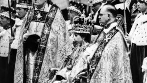 Queen Elizabeth II, surrounded by the bishop of Durham Lord Michael Ramsay (L) and the bishop of Bath and Wells Lord Harold Bradfield, receives homage and allegiance from her subjects during her coronation ceremony on June 02, 1953 in Westminster Abbey, London