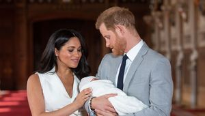 Britain\'s Prince Harry, Duke of Sussex (R), and his wife Meghan, Duchess of Sussex, pose for a photo with their newborn baby son, Archie Harrison Mountbatten-Windsor, in St George\'s Hall at Windsor Castle in Windsor, west of London on May 8, 2019