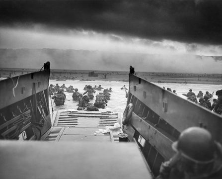 Digitally restored vintage World War II photo of American troops wading ashore on Omaha Beach during the D-Day invasion on June 6, 1944