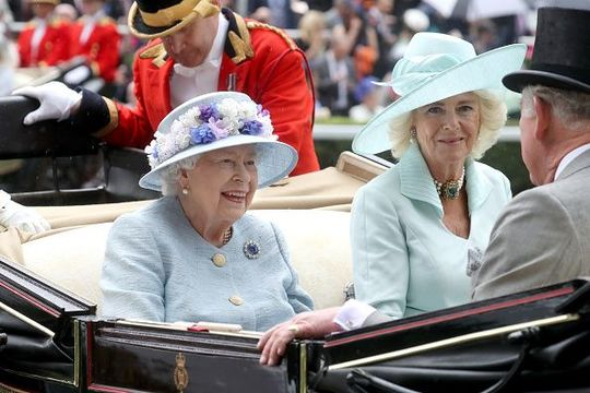 Queen Elizabeth II and Camilla, Duchess of Cornwall arrive in a horse carriage on day two of Royal Ascot at Ascot Racecourse