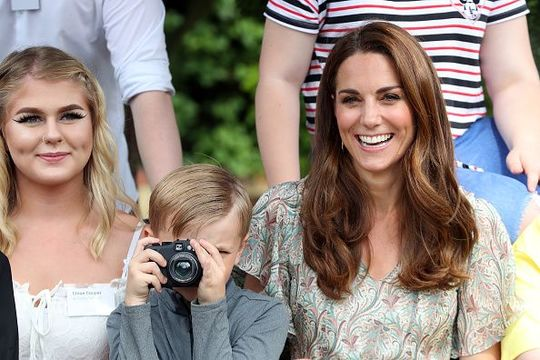 Catherine, Duchess of Cambridge and Josh Evans at photography workshop for Action for Children, run by the Royal Photographic Society