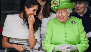 Queen Elizabeth II sitts and laughs with Meghan, Duchess of Sussex during a ceremony to open the new Mersey Gateway Bridge on June 14, 2018 in the town of Widnes in Halton, Cheshire, England