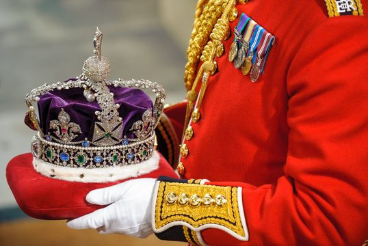 The Imperial State Crown is carried through the Norman Porch of the Palace of Westminster during the State Opening of Parliament on May 09, 2012 in London, England