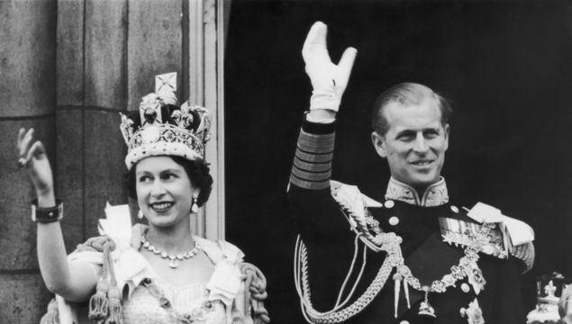 2nd June 1953: Queen Elizabeth II and the Duke of Edinburgh wave at the crowds from the balcony at Buckingham Palace.