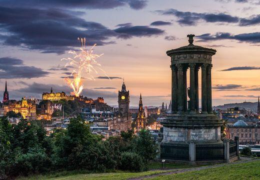 Fireworks over the Edinburgh skyline, as seen from Calton Hill.