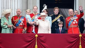Queen Elizabeth II and the Royal Family waving from the balcony of Buckingham Palace.