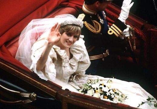 The Prince and Princess of Wales return to Buckingham Palace by carriage after their wedding, 29th July 1981. She wears a wedding dress by David and Elizabeth Emmanuel and the Spencer family tiara. (Photo by Terry Fincher/Princess Diana Archive/Getty Images)